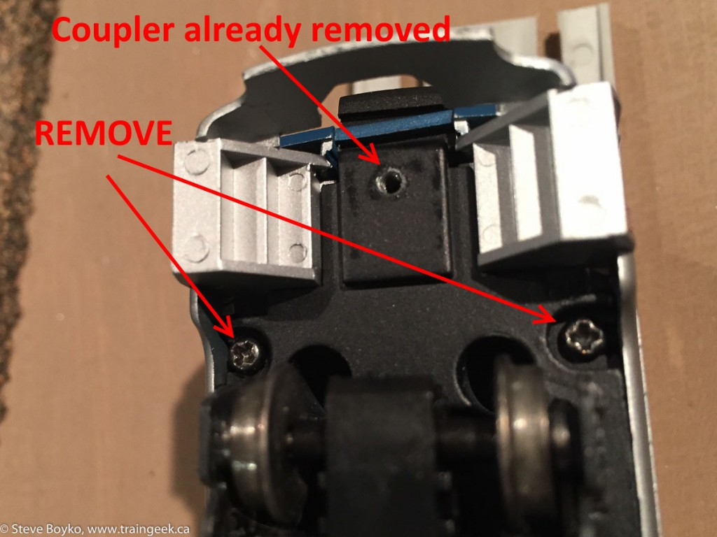 Coupler removed, other screws to remove