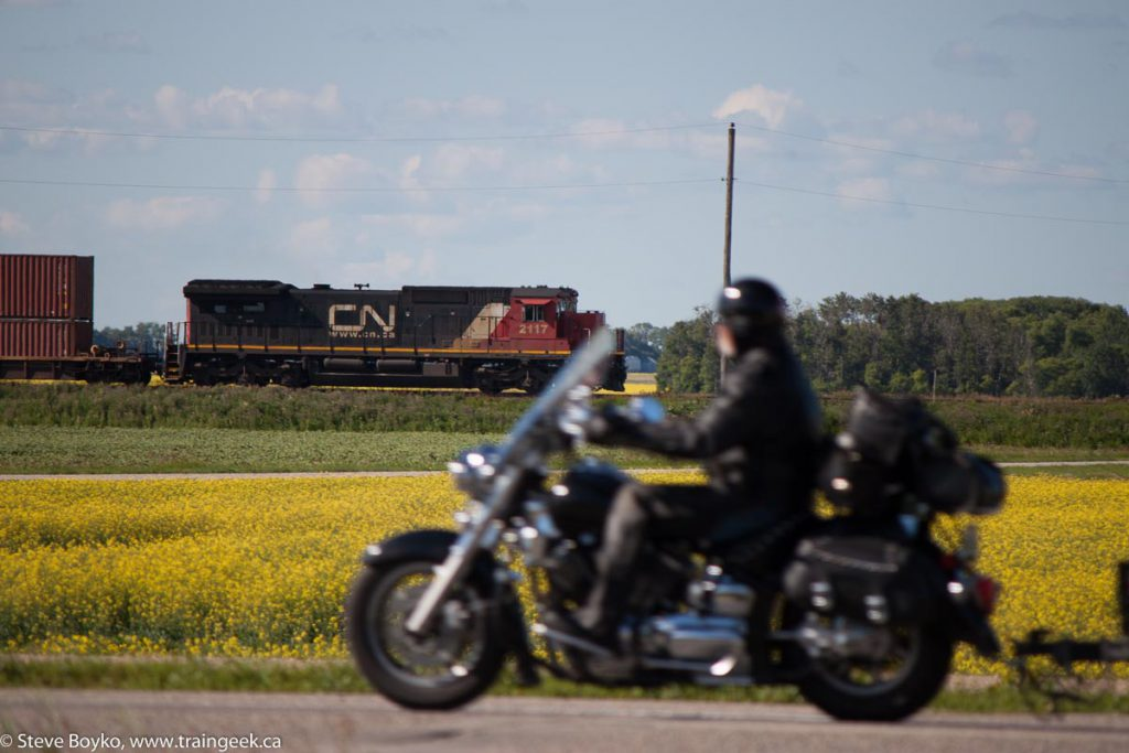 Motorcycle, Canola and a Train